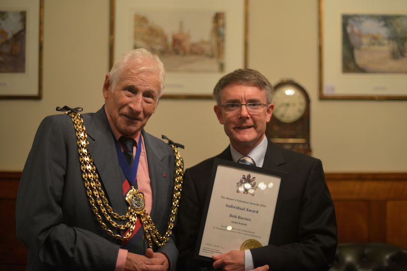 Cllr. David Powell presents Bob Barnes with his Mayor's Volunteer Award.